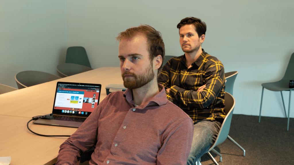 men sitting in an office room